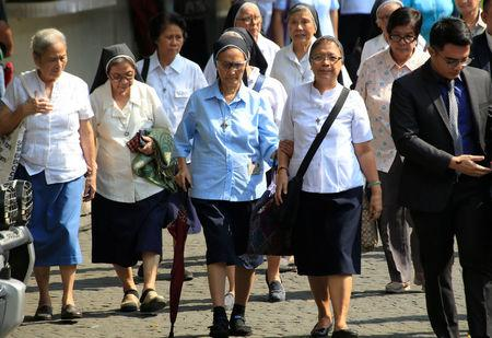 Nuns enter the Supreme Court's compound to attend the start of the of the oral arguments on the consolidated petitions to declare Philippine President Rodrigo Duterte's drug war unconstitutional at the Supreme Court in Manila, Philippines November 21, 2017. REUTERS/Romeo Ranoco