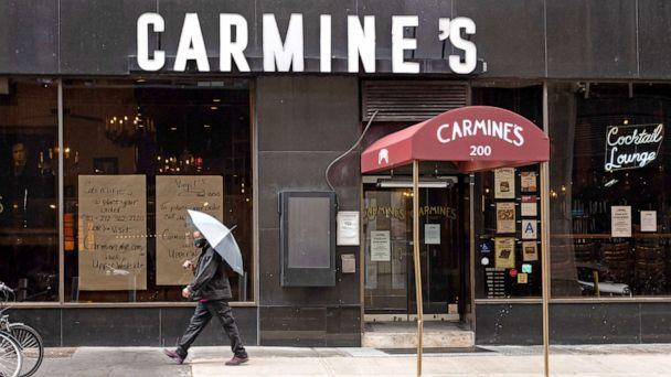 PHOTO: A person walks outside Carmine's Italian Restaurant in Times Square on Oct. 13, 2020 in New York City. (Noam Galai/Getty Images, FILE)