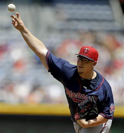 Minnesota Twins starting pitcher Vance Worley throws in the first inning of a baseball game against the Atlanta Braves, Wednesday, May 22, 2013, in Atlanta. (AP Photo/David Goldman)
