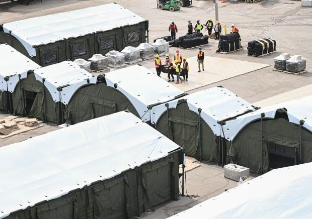 Construction workers set up a makeshift hospital at Sunnybrook Hospital in Toronto back on March 11, 2021.