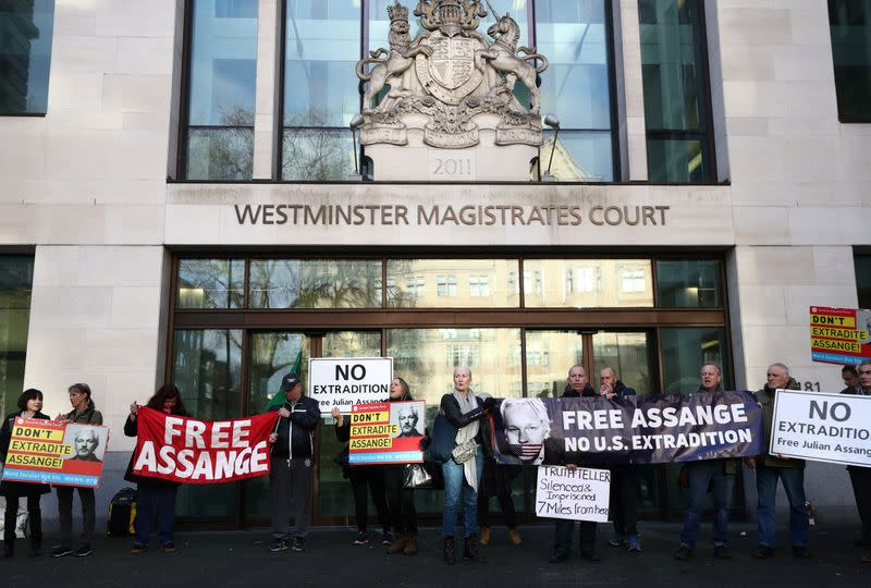 Supporters of WikiLeaks' founder Julian Assange gather outside Westminster Magistrates Court in London