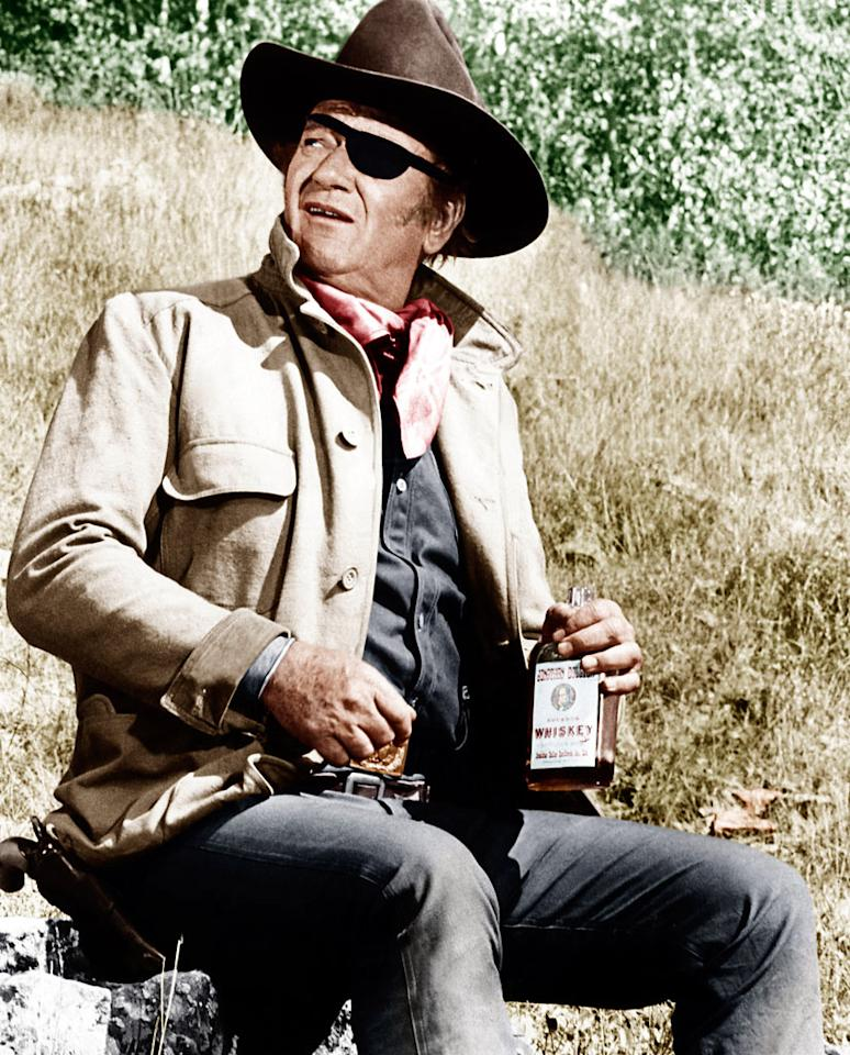 "John Wayne, Best Actor, 'True Grit' (1969)  A hard-drinking, hard-nosed U.S. Marshal teams up with a teenage tomboy (Kim Darby) to find her father's killer. ""I hope you don't think I'm going to keep you in whiskey!"" she harrumphs at the outset of their trek. He replies, ""I don't buy that, I confiscate it. And a touch of it wouldn't do you any harm against the night air! … It's the real article. Genuine, double-rectified bust head. Aged in the keg."""