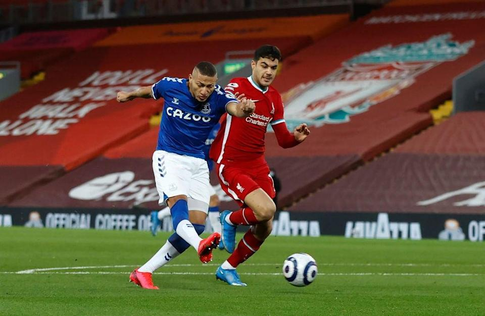 <p>Richarlison finishes for Everton under pressure from Ozan Kabak</p> (Getty)