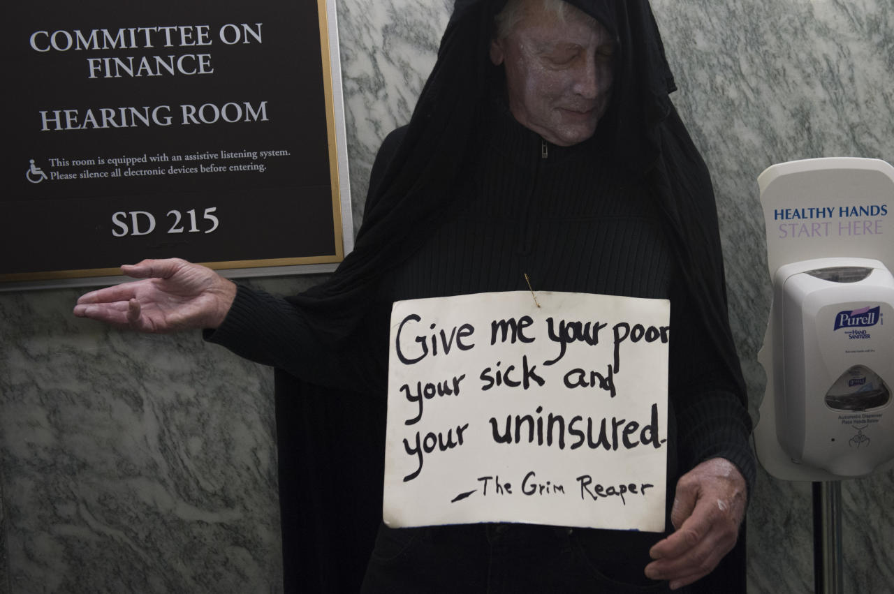 <p>A man dressed as the grim reaper waits in line for a US Senate Committee on Finance hearing on the Graham-Cassidy-Heller-Johnson Proposal on reforming health care on Capitol Hill in Washington, DC, September 25, 2017. (Photo: Saul Loeb/AFP/Getty Images) </p>