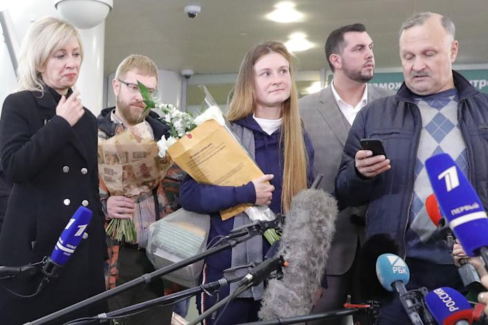 Russian citizen Maria Butina (center) is seen with her father Valery Butin (right) while talking to reporters in Russia following her deportation. (Photo: Mikhail Japaridze via Getty Images)