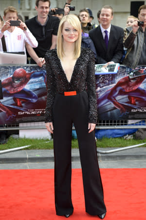 Attending the Premiere of The Amazing Spider-Man in London, Emma Stone looks classic in a sparkling black plunge blouse and black tuxedo pants.