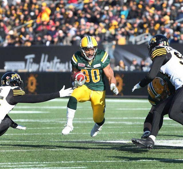 Edmonton running back John White's bursts keyed the Eskimos past Hamilton and into the eastern final. (THE CANADIAN PRESS/Peter Power photo)