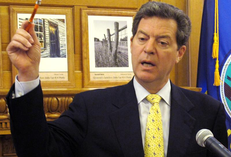 Kansas Gov. Sam Brownback makes a point in discussing the state's finances during a news conference, Wednesday, July 25, 2012, at the Statehouse in Topeka, Kan. Brownback argues that income tax cuts approved this year won't cause big budget problems in the future, as critics fear. (AP Photo/John Hanna)