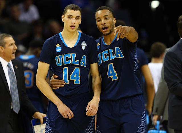 MEMPHIS, TN - MARCH 27: Norman Powell #4 speaks with Zach LaVine #14 of the UCLA Bruins during a regional semifinal of the 2014 NCAA Men's Basketball Tournament against the Florida Gators at the FedExForum on March 27, 2014 in Memphis, Tennessee. (Photo by Streeter Lecka/Getty Images)
