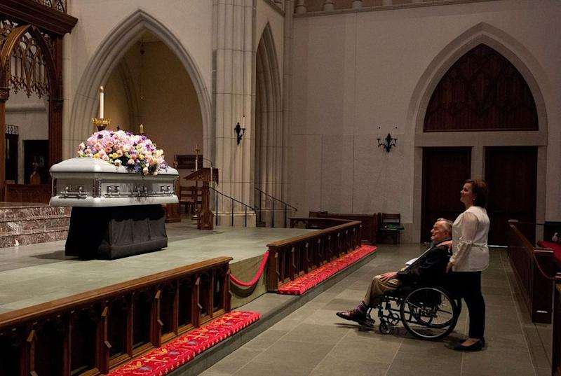 George H.W. Bush alongside daughter Dorothy as he gazed up at his wife, Barbara's, casket