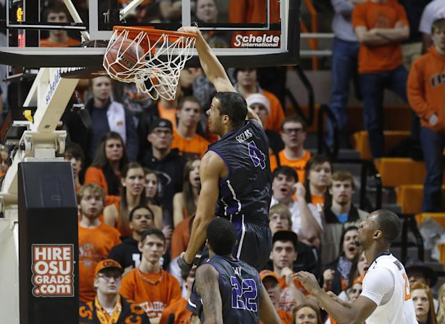 TCU forward Amric Fields (4) dunks in front of teammate Jarvis Ray (22) and Oklahoma State post Kamari Murphy (21) during the second half of an NCAA college basketball game in Stillwater, Okla., Wednesday, Jan. 15, 2014. Oklahoma State won 82-50. (AP Photo/Sue Ogrocki)