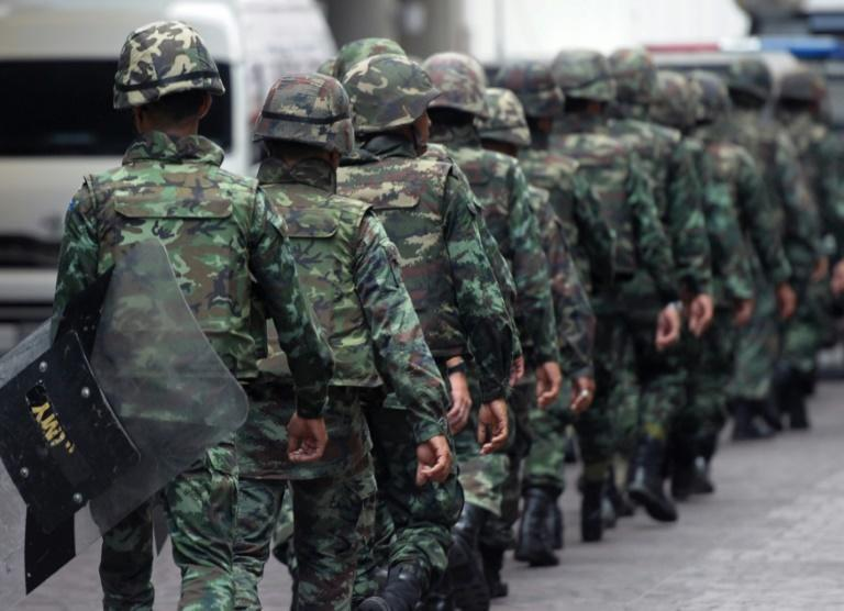 Thai soldiers are seen patrolling an intersection in Bangkok