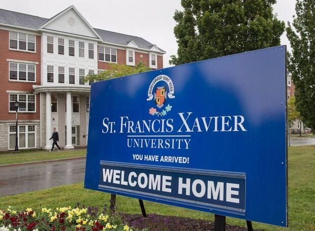 A sign marks one of the entrances to the St. Francis Xavier University campus in Antigonish, N.S., on Friday, Sept. 28, 2018. The school is investigating an incident where people climbed on an ambulance Sunday night. (Andrew Vaughan/The Canadian Press - image credit)