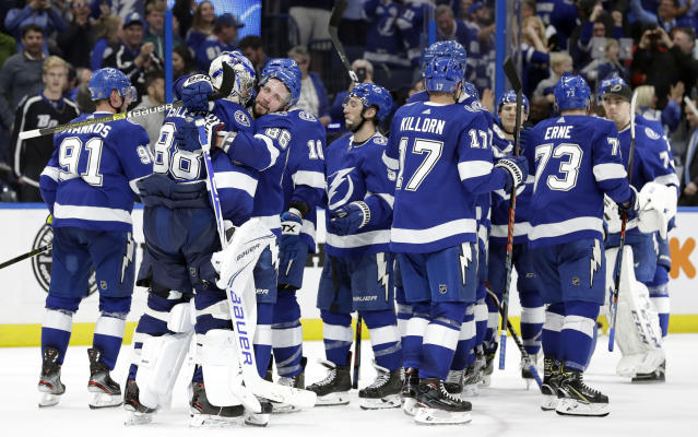 The Tampa Bay Lightning celebrate their 4-3 shootout win over the Los Angeles Kings during an NHL hockey game Monday, Feb. 25, 2019, in Tampa, Fla. (AP Photo/Chris O'Meara)