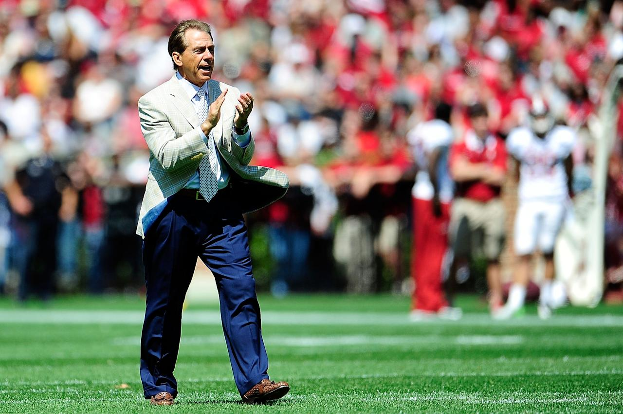 TUSCALOOSA, AL - APRIL 20:  Nick Saban, head coach of the Alabama Crimson Tide applauds his team during the Alabama A-Day spring game at Bryant-Denny Stadium on April 20, 2013 in Tuscaloosa, Alabama.  (Photo by Stacy Revere/Getty Images)