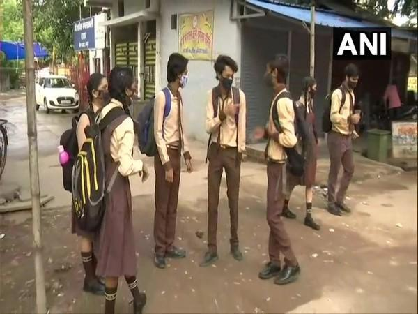 Students of Holy Cross School after their school re-opened in Raipur on Monday. [Photo/ANI]