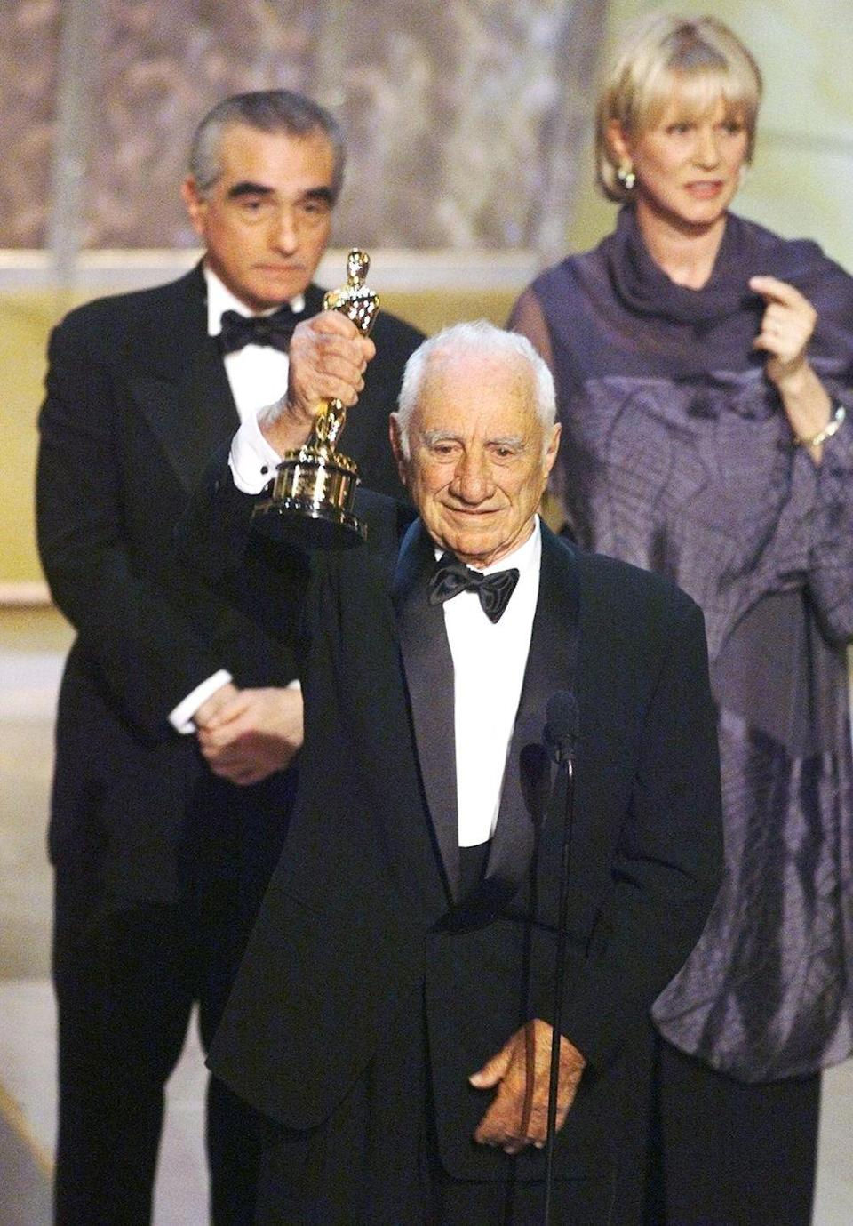 """<p><a href=""""http://articles.latimes.com/1999/mar/22/news/mn-19738"""" rel=""""nofollow noopener"""" target=""""_blank"""" data-ylk=""""slk:Elia Kazan was a controversial figure"""" class=""""link rapid-noclick-resp"""">Elia Kazan was a controversial figure</a> in Hollywood. He had previously testified in front of the House Un-American Activities Committee in 1952 at the height of the Red Scare, telling them about eight of his old friends who had been members of the Communist Party, <a href=""""https://en.wikipedia.org/wiki/Elia_Kazan"""" rel=""""nofollow noopener"""" target=""""_blank"""" data-ylk=""""slk:effectively ending"""" class=""""link rapid-noclick-resp"""">effectively ending</a> their careers. Because of this, there were protestors gathered outside the ceremony to oppose Kazan receiving the award. Notably, actors Nick Nolte, Ed Harris, and Amy Madigan made a point of staying in their seats and not applauding when Kazan took the stage. </p>"""