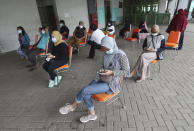 People wait for a coronavirus rapid test at the Patriot Candrabhaga Stadium in Bekasi, Indonesia, Monday, Jan. 25, 2021. Indonesia has reported more cases of the virus than any other countries in Southeast Asia. (AP Photo/Achmad Ibrahim)