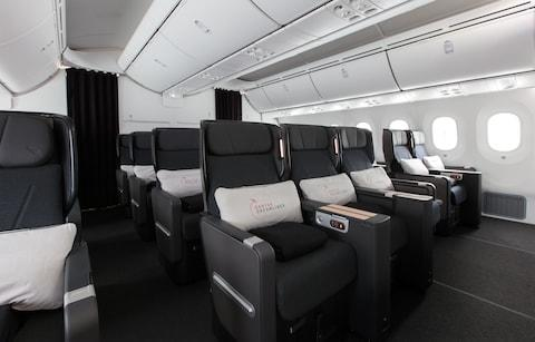 A premium economy cabin on the Qantas Dreamliner - Credit: Qantas Airways Limited/Brent Winstone