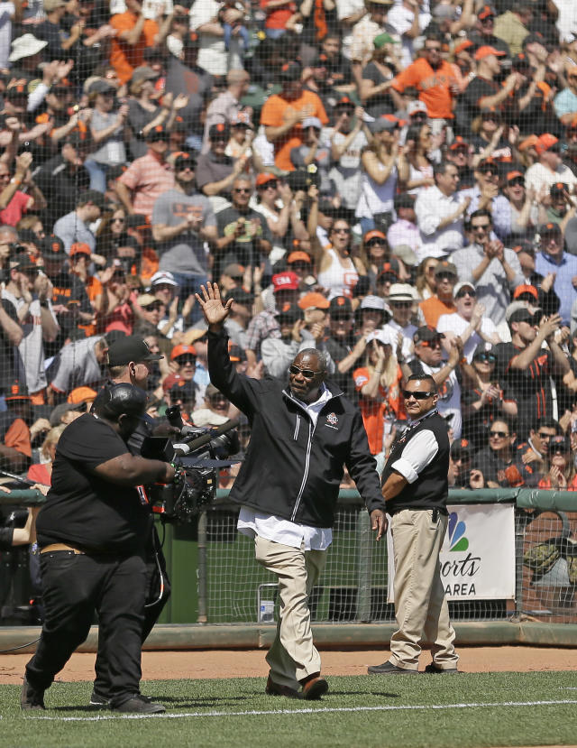 FILE- In this April 3, 2018, file photo, Dusty Baker waves at AT&T Park after being introduced before the start of an opening day baseball game between the San Francisco Giants and the Seattle Mariners in San Francisco. Baker lost his job with Washington after last season, when he guided the Nationals to a second straight NL East title. It has been a blessing of sorts. Baker never forgets to remind himself of his good fortune, even during the down times in his big league baseball career spanning a half-century. Sure, he still wants to manage and go out on his own terms when the time comes. (AP Photo/Eric Risberg, File)