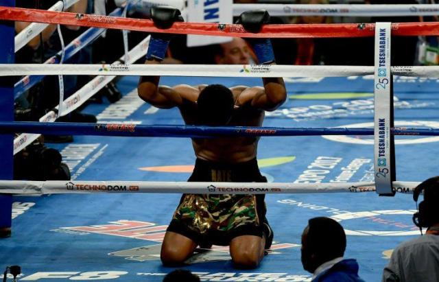 Daniel Jacobs drops to his knees after learning he lost his middleweight title unification bout with Gennady Golovkin on March 18 at Madison Square Garden in New York. (Getty Images)