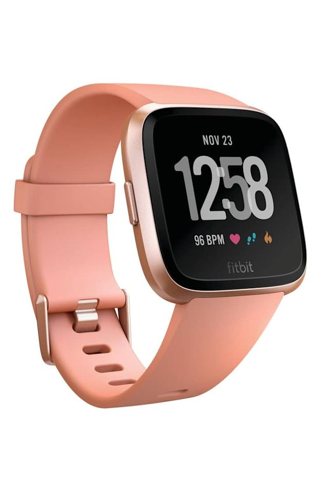"<p>This <a href=""https://www.popsugar.com/buy/Fitbit-Versa-Smart-Watch-317513?p_name=Fitbit%20Versa%20Smart%20Watch&retailer=fitbit.com&pid=317513&price=200&evar1=fit%3Aus&evar9=45654939&evar98=https%3A%2F%2Fwww.popsugar.com%2Ffitness%2Fphoto-gallery%2F45654939%2Fimage%2F45654945%2FFitbit-Versa-Smart-Watch&list1=shopping%2Cfitness%2Cworkouts%2Cfitness%20gear%2Chealthy%20living%20tips%2Cfitness%20trackers&prop13=mobile&pdata=1"" rel=""nofollow"" data-shoppable-link=""1"" target=""_blank"" class=""ga-track"" data-ga-category=""Related"" data-ga-label=""https://www.fitbit.com/shop/versa"" data-ga-action=""In-Line Links"">Fitbit Versa Smart Watch</a> ($200) is the fitness tracker everyone's been obsessing over in 2019. Link it up to your smartphone to play your favorite music, check your texts, and track your heart rate.</p>"
