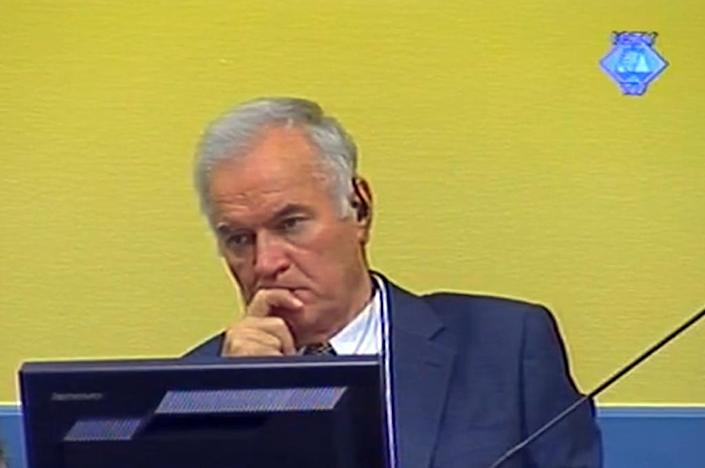 Ratko Mladic listening to the first prosecution witness in The Hague courtroom back in July 2012 (AFP Photo/HO)