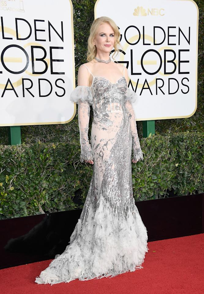 """<p>Nicole revealed that her two daughters chose her Alexander McQueen dress for the night – even though she wouldn't have picked it. """"I was trying all the frocks on and when I put this on they both jumped up and said """"Mummy, you look like a beautiful fairy on that dress!"""" So that was it. I stopped trying on any of the others and said to them that I'm wearing the fairy dress to the Globes,"""" she told the <i>Daily Mail</i>. <i>[Photo: Getty]</i> </p>"""