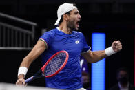Team Europe's Matteo Berrettini, of Italy, celebrates his victory over Team World's Felix Auger-Aliassime, of Canada, at Laver Cup tennis, Friday, Sept. 24, 2021, in Boston. (AP Photo/Elise Amendola)