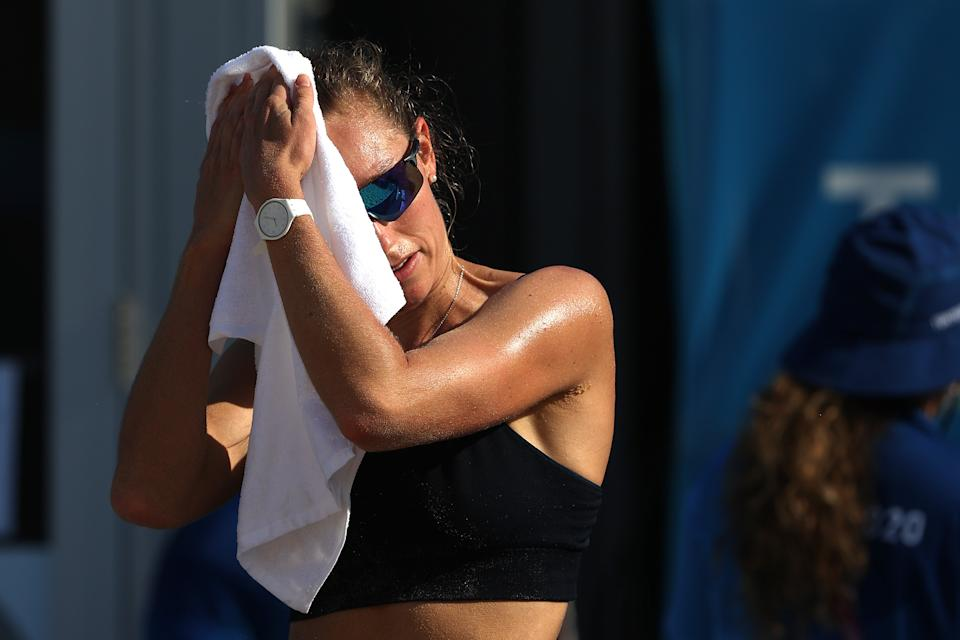 <p>Nina Betschart of Team Switzerland Women's Beach Volleyball uses a towel to cool down while training at Shiokaze Park ahead of the Tokyo 2020 Olympic Games on July 20, 2021 in Tokyo, Japan. (Photo by Sean M. Haffey/Getty Images)</p>