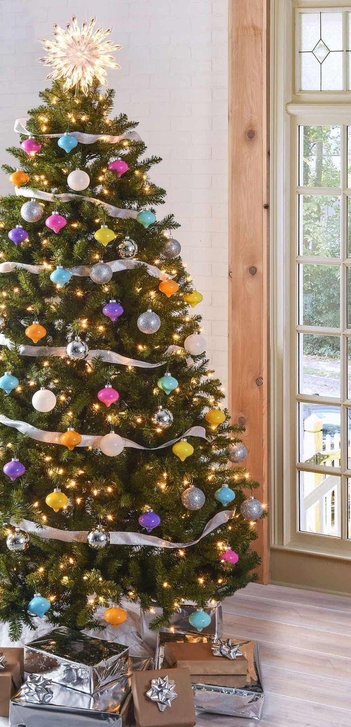 "<p>Red and green are officially out—DIY your own colorful pink, blue, yellow, purple, and orange ornaments for a new kind of Christmas tree.</p><p>Get the tutorial at <a href=""https://modpodgerocksblog.com/colorful-vintage-inspired-christmas-tree/"" rel=""nofollow noopener"" target=""_blank"" data-ylk=""slk:Mod Podge Rocks"" class=""link rapid-noclick-resp"">Mod Podge Rocks</a>.</p><p><a class=""link rapid-noclick-resp"" href=""https://www.amazon.com/Topenca-Supplies-Inches-Double-Ribbon/dp/B01ENR5TVA/ref=sr_1_1_sspa?dchild=1&keywords=silver+ribbon&qid=1597240470&sr=8-1-spons&psc=1&spLa=ZW5jcnlwdGVkUXVhbGlmaWVyPUExRlpTSFk3Qjg2Q0VDJmVuY3J5cHRlZElkPUEwNTg0MTgyWFc3UVY1N01TTVBEJmVuY3J5cHRlZEFkSWQ9QTA1MTYyNzQxTE9UNlNZSlUwUjBIJndpZGdldE5hbWU9c3BfYXRmJmFjdGlvbj1jbGlja1JlZGlyZWN0JmRvTm90TG9nQ2xpY2s9dHJ1ZQ%3D%3D&tag=syn-yahoo-20&ascsubtag=%5Bartid%7C10057.g.505%5Bsrc%7Cyahoo-us"" rel=""nofollow noopener"" target=""_blank"" data-ylk=""slk:SHOP RIBBON"">SHOP RIBBON</a> <strong><em>Silver Ribbon, $15</em></strong></p>"