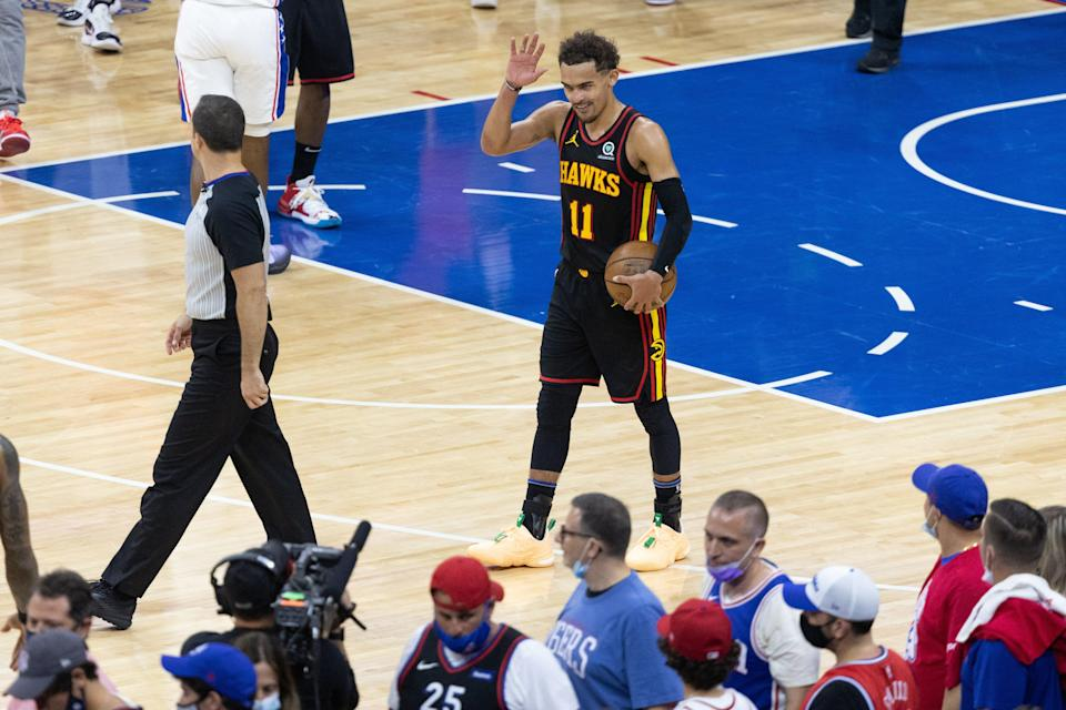 Hawks guard Trae Young reacts waves to the 76ers fans after helping Atlanta advance to the Eastern Conference finals.