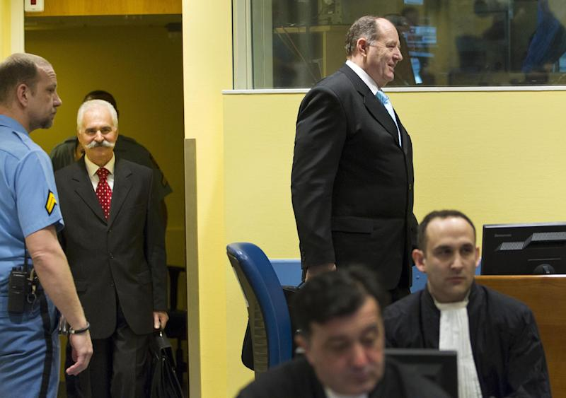 Former Bosnian Serb minister of internal affairs and national police chief Mico Stanisic, second right, and former Bosnian Serb senior security official and police chief Stojan Zupljanin, second left, enter the courtroom prior to their judgment at the Yugoslav war crimes tribunal in The Hague, Netherlands, Wednesday March 27, 2013. UN judges will deliver verdicts in the trial of two former Bosnian Serb police chiefs, both charged with crimes including persecution, extermination, murder, torture and deportation for their alleged roles in a criminal conspiracy led by Bosnian Serb President Radovan Karadzic and his military chief Gen. Ratko Mladic to force Muslims and Croats out of what they considered to be Serb territory in Bosnia. (AP Photo/Michael Kooren, pool)