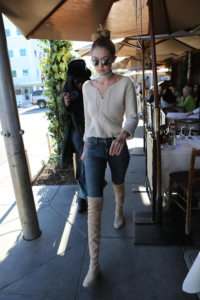 <p>A few months ago, Hadid stepped out in a flat version of the same Stuart Weitzman boots, pairing them with a boho-hippie look while out in Los Angeles, Calif.</p><p>(Photo: Splash)</p>