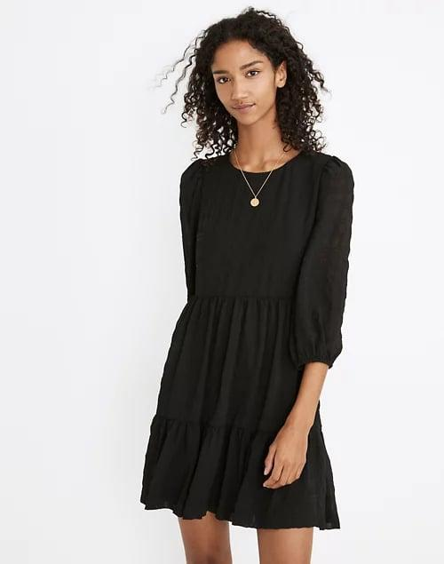 <p>This <span>Madewell Petite Puff-Sleeve Ruffle-Hem Mini Dress</span> ($70, originally $128) is a great pick for a chilly spring - or even summer - night, as it's made of a breezy fabric with sheer sleeves. </p>