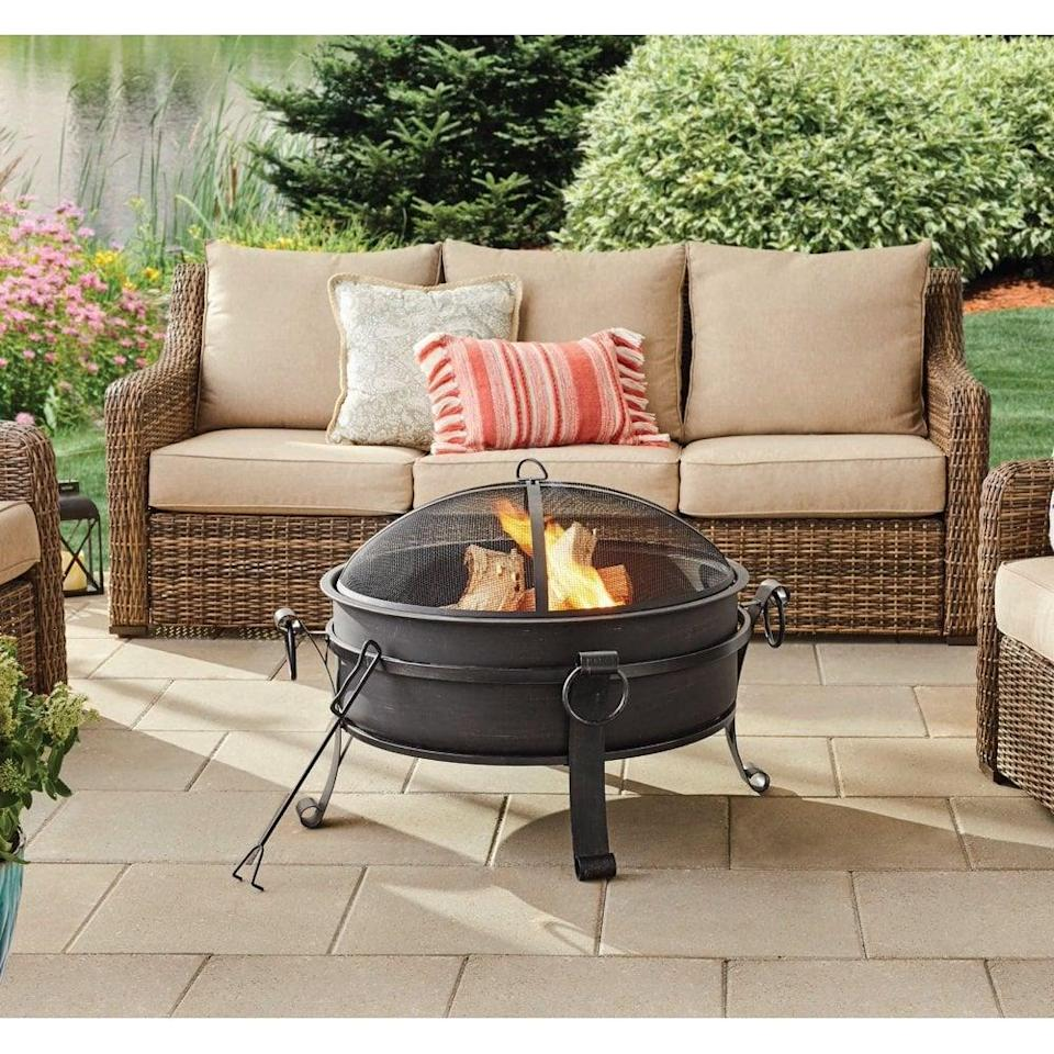 <p>This <span>Better Homes & Gardens Fire Pit & Table</span> ($147) is ideal for small yards.</p>