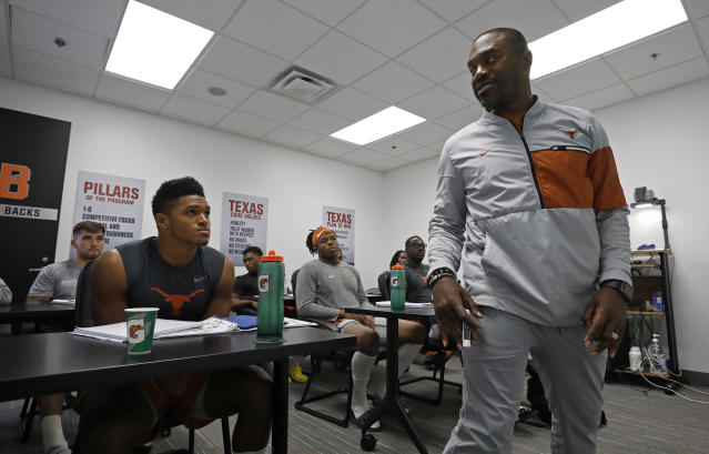 Texas Longhorns associate head coach and run game coordinator Stan Drayton (right) talks with player Roschon Johnson (left) as Keaontay Ingram (center), David Gbenda (center right) and other listen during a meeting Wednesday Sept. 4, 2019 in Austin, Tx. ( Photo by Edward A. Ornelas )