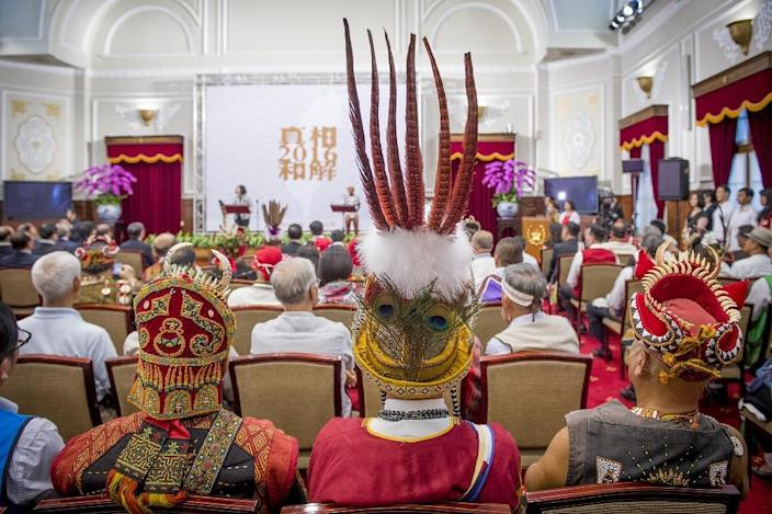 Representatives from some of Taiwan's 16 indigenous tribes attend a ceremony at the presidential office in Taipei on August 1, 2016 (AFP Photo/Presidential Office)