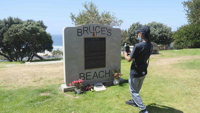FILE - This April 8, 2021 file photo, shows a monument at Bruce's Beach in Manhattan Beach, Calif.. Los Angeles County leaders took initial steps Tuesday, April 20, 2021, toward returning prime beachfront property to descendants of a Black couple who built a resort for African Americans but were stripped of the land by local city officials a century ago. (Dean Musgrove/The Orange County Register via AP, File)