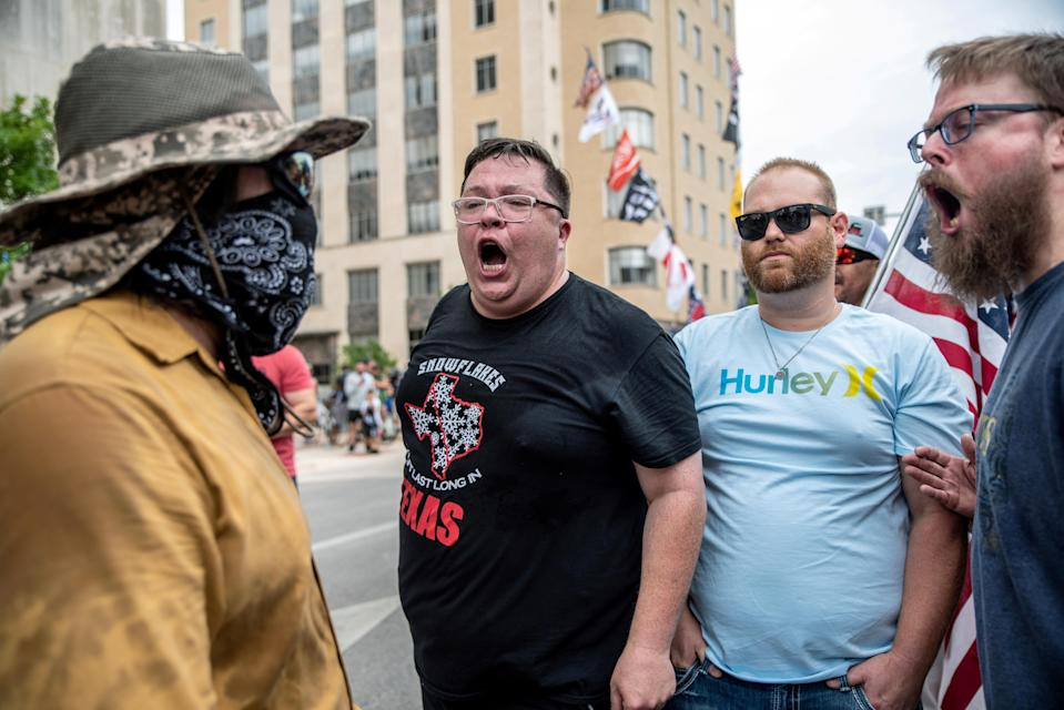 People protest against mandates to wear masks amid the coronavirus disease (COVID-19) outbreak in Austin, Texas, U.S., June 28, 2020. REUTERS/Sergio Flores TPX IMAGES OF THE DAY