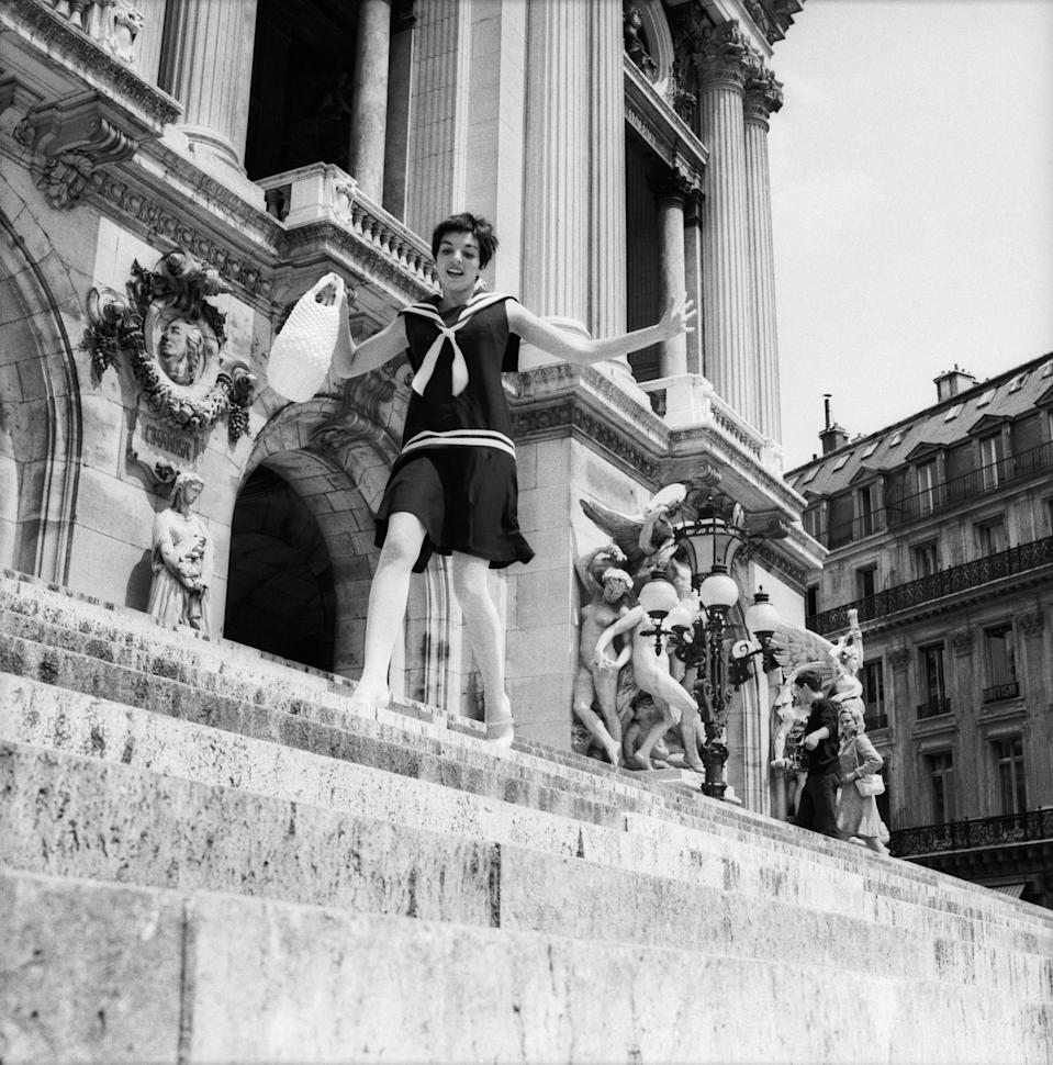 A teenage Minnelli walks along the steps of the Opera House in Paris, France