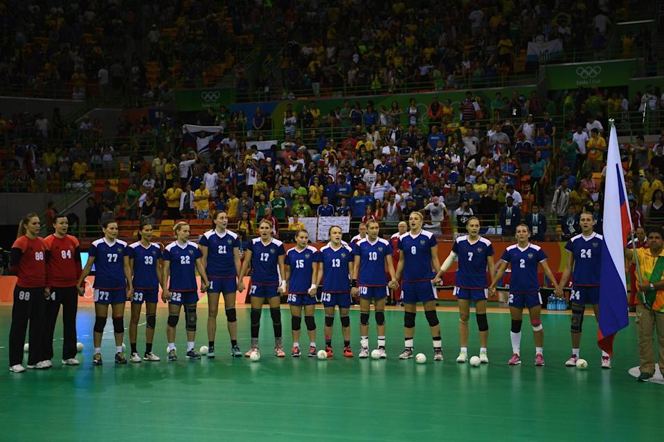 <p>Russia stands for their national anthem during the Women's Handball Gold medal match between France and Russia at Future Arena on Day 15 of the Rio 2016 Olympic Games at the Future Arena on August 20, 2016 in Rio de Janeiro, Brazil. (Photo by David Ramos/Getty Images) </p>