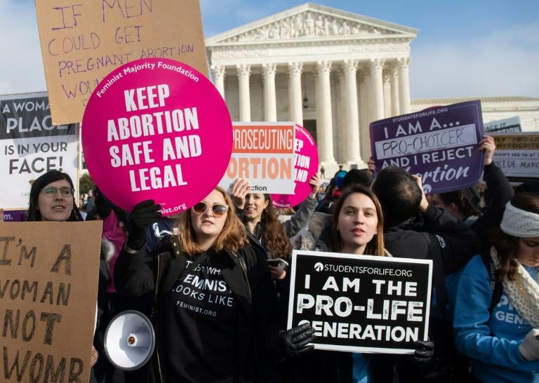 Pro-choice and anti-abortion activists demonstrate outside the Supreme Court in January 2019 -- the court will hear a major case on the issue in its upcoming 2019-2020 term