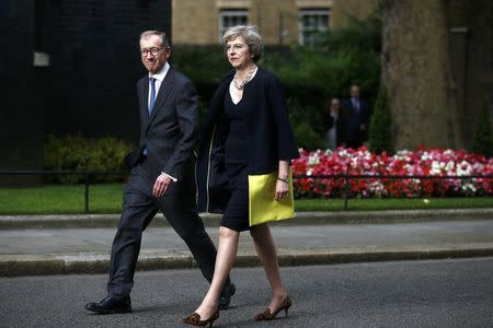 Britain's Prime Minister, Theresa May, and husband Philip walk up Downing Street, in central London, Britain July 13, 2016.         REUTERS/Peter Nicholls