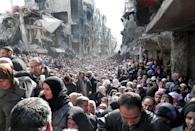 <p>2014. Palestinian refugees line up for food in Yarmouk, Damascus, Syria.</p>