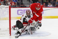 Arizona Coyotes goaltender Darcy Kuemper (35) stops a Detroit Red Wings center Andreas Athanasiou (72) shot in the second period of an NHL hockey game Tuesday, Nov. 13, 2018, in Detroit. (AP Photo/Paul Sancya)