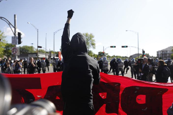 <p>A demonstrator raises his fist during the G7 Summit in Quebec City, Quebec, Canada, June 8, 2018. (Photo: Mathieu Belanger/Reuters) </p>