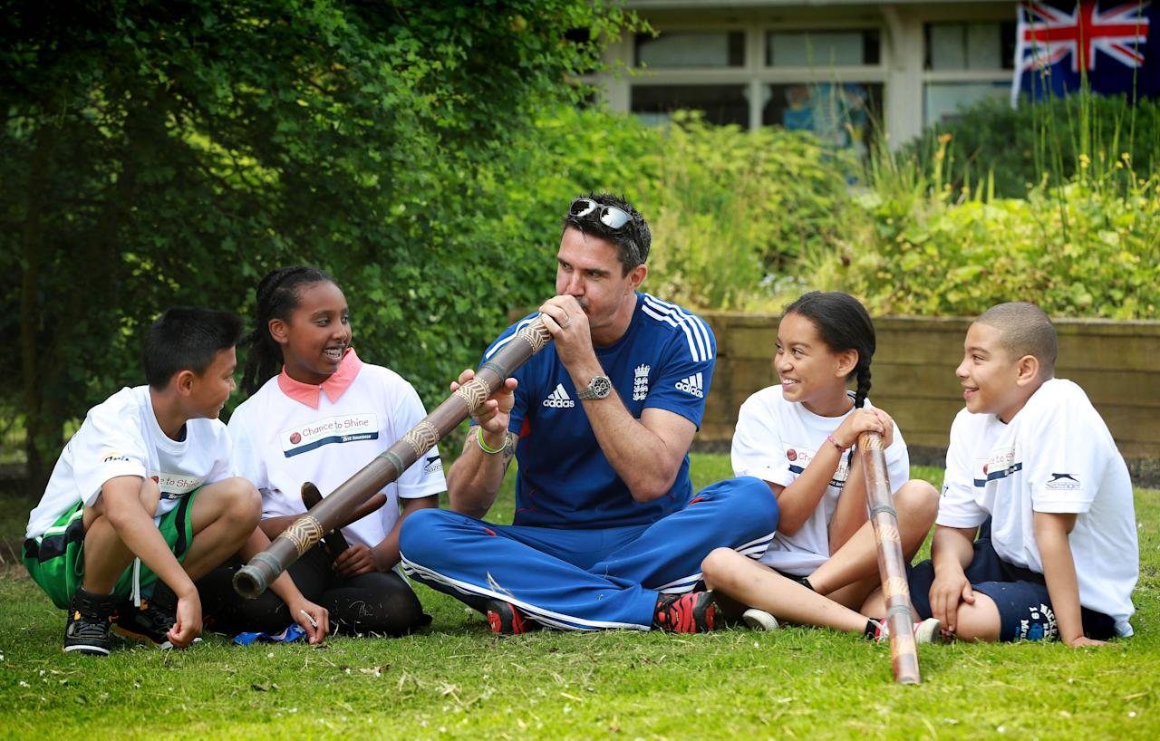 EDITORIAL USE ONLYEngland cricketer Kevin Pietersen plays the didgeridoo with (left to right) Timothy Remigio aged 10, Million Dawit aged 11, Alannah Cummins-Powell aged 11 and Rio Jones aged 10 during the Australian themed celebrations for the sixth anniversary of Chance to Shines Brit National Cricket Day, at Sacred Heart Primary School in Battersea, London.