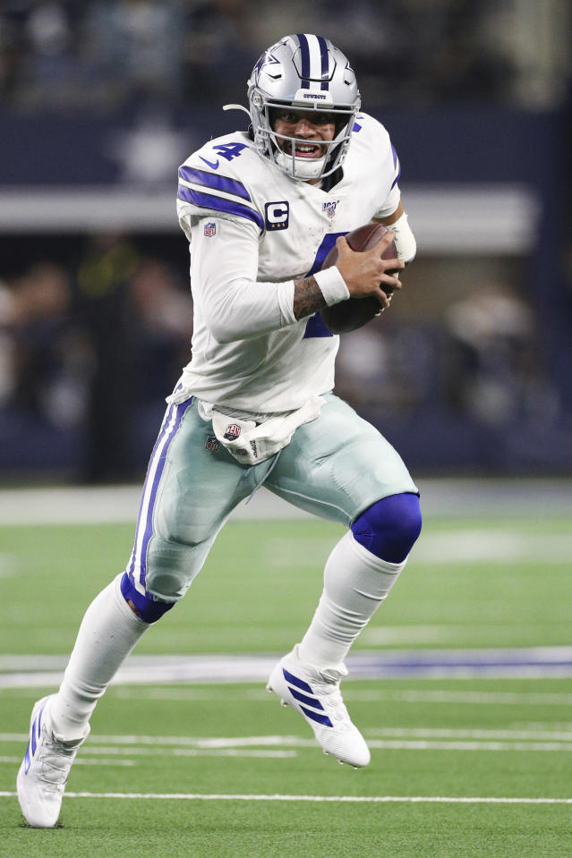 Dallas Cowboys quarterback Dak Prescott (4) scrambles with the ball in an NFL game against the Buffalo Bills, Thursday, Nov. 28, 2019 in Dallas. The Bills defeated the Cowboys 26-15. (Margaret Bowles via AP)