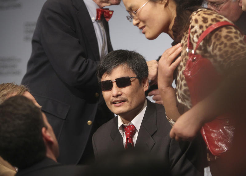 Chen Guangcheng talks with people after speaking at the Council on Foreign Relations in New York, Thursday, May 31, 2012.  Guangcheng is a blind Chinese activist whose dramatic escape from a house arrest culminated in a flight to the U.S. this month. (AP Photo/Seth Wenig)
